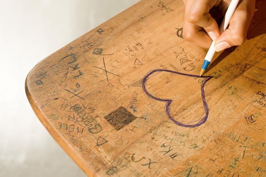 kids drawing on desk