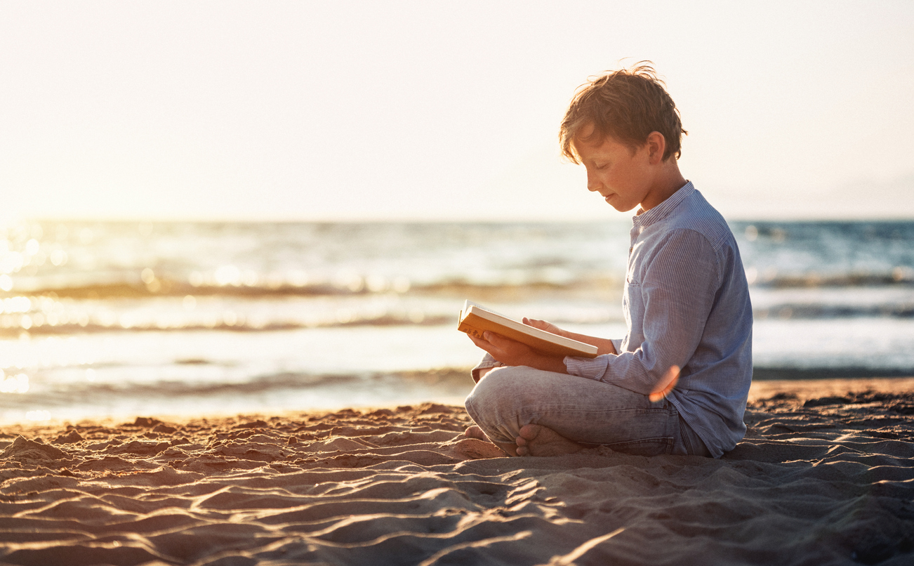 studying on the beach